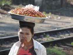 A track side hawker with a thanaka painted face