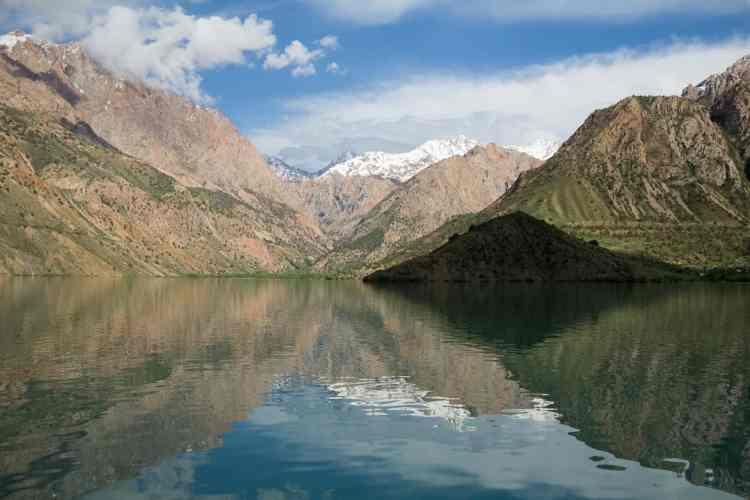 Iskanderkul Lake surrounded by mountains in Tajikistan