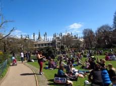 The crowds enjoying the sun near the Royal Pavillion, Brighton, England