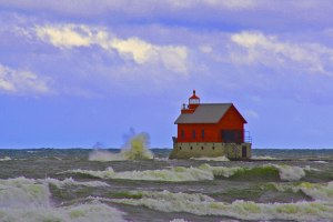 image of Grand Haven pier in Grand Haven, Michigan with waves rolling into the beach.