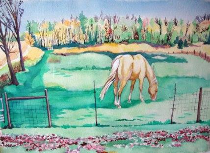 Beige horse in a pasture.