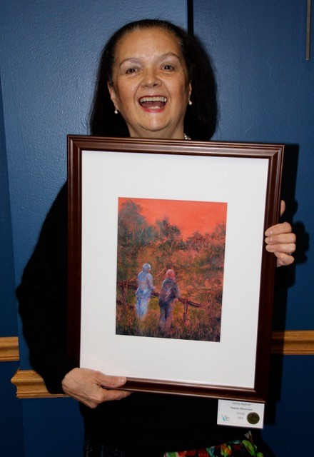 Woman holding a painting