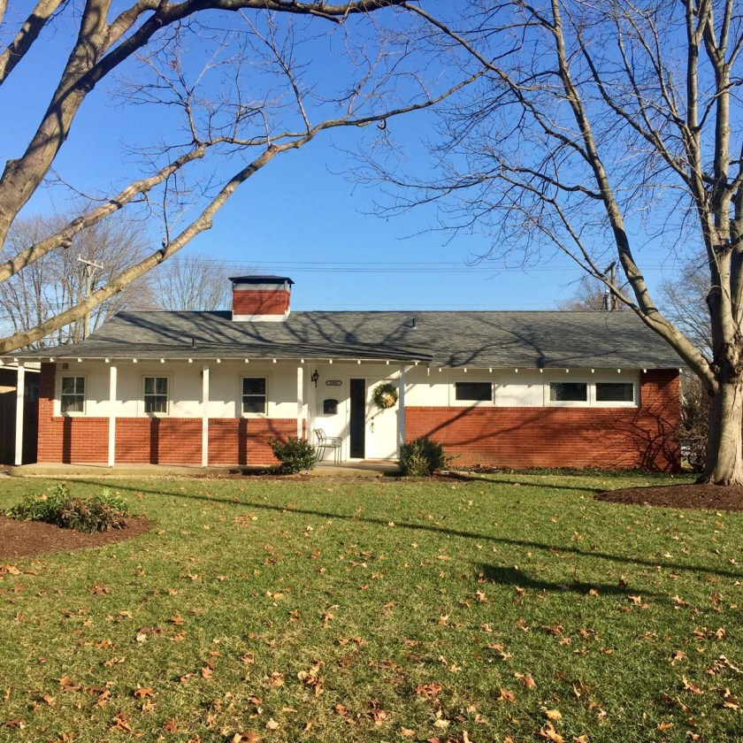 brick and white clapboard mid-century ranch