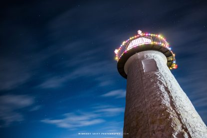 A starry sky and clouds sweeping above Ned's Lighthouse in Mattapoisett, Massachusetts.
