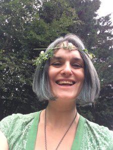 Annastasia Ward wearing flower garland with trees in background