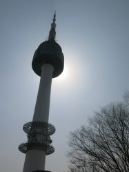 Seoul Tower partially hiding the sun. It looks like it's about to blast a spirit ball!