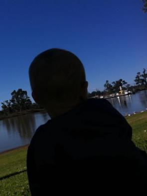 W sitting at the river front at Waikerie watching the ferry.