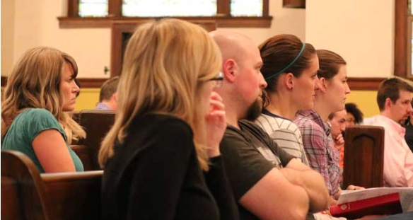 File Photo. Parents at a Midtown Community School Initiative meeting in 2014.