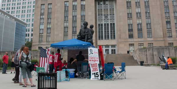 File photo. Supporters of a minimum wage hike camped out in front of City Hall in July, 2015.