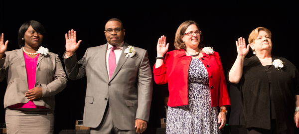 New councilmembers Alissia Canaday and Lee Barnes, fifth district and Jolie Justus and Katheryn Shields, fourth district, took the oath of office with other council members on Saturday.