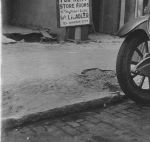 deteriorating curb and sidewalk in 1930.