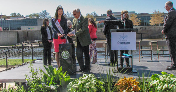 """City of Fountains Foundation Board Member Carl DiCappo and """"Miss City of Fountains"""" Sophia Dominguez turned on the first fountain today."""
