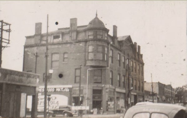 Although the buildings that once lined Thirty-first Street and wrapped around the corner on Holmes are gone now, this area was a thriving business and entertainment area in the 1920s through the 1940s. This building which stood at 3110 Holmes in this 1940 photo housed a variety of businesses during those years.