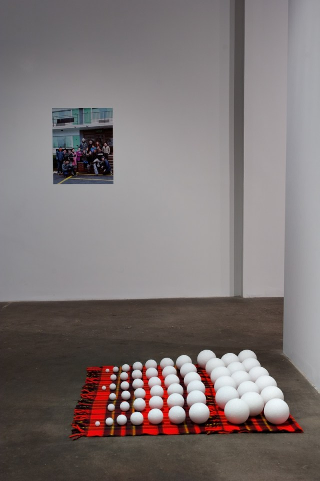 The Way It Wasn't (Celebrating ten years of castillo/corrales, Paris), installation view. Background: Jay Chung & Q Takeki Maeda, Nothing is More Practical than Idealism, 2001. Digital photograph. Foreground: Joe Scanlan, Idée Fixe, 2009. Polystyrene balls, wool blanket.