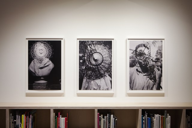 Gareth James, Left to right: Untitled (Sir John Soane Bust with White Regular Circle), 2011. Untitled (Edward Curtis with White to Black Spiral), 2010. Untitled (Young Claude Levi-Strauss with Monkey, Fragment Spirals), 2011. All works: Chomogentic prints. 32 ¾ x 22 ½ inches framed. Courtesy Miguel Abreu Gallery, NY.