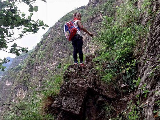 635999471084182704-AP-China-Village-Ladder.1