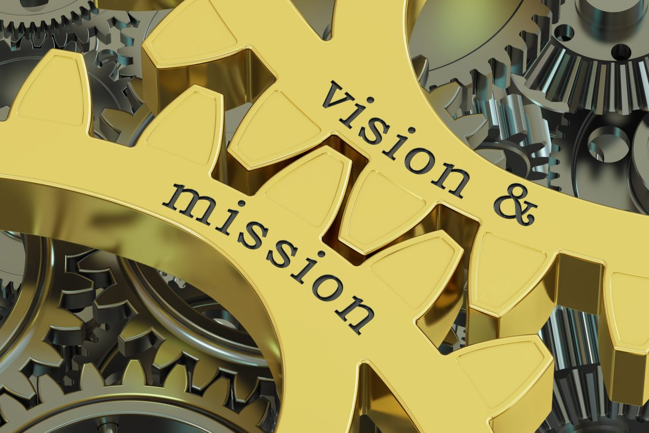 The words vision and mission on two gold gears