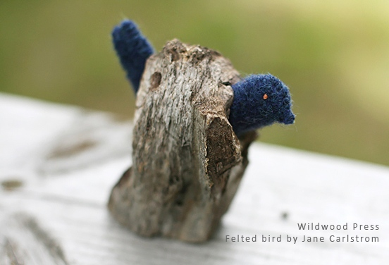 Woolen Fabric Felt sewn from fulled wool fabric, perched in found tree branch hole.