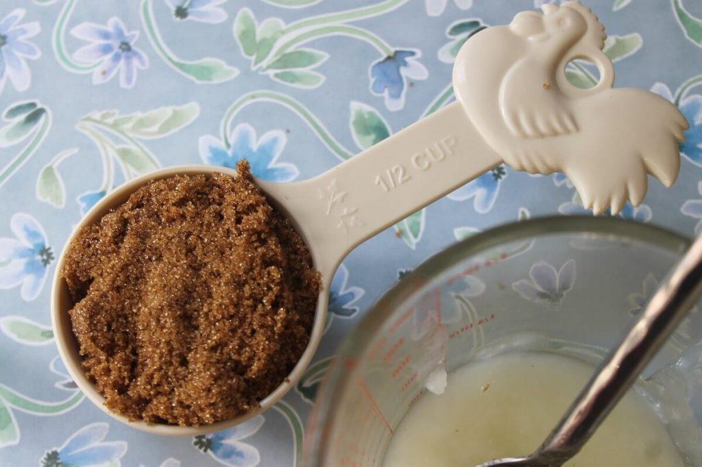 Brown sugar in a measuring spoon for Brown Sugar Scrub with Green Tea & Peppermint