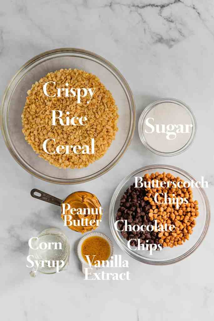 The ingredients for this O'Henry Bars Recipe are in a variety of bowls and measuring cups on a marble background.