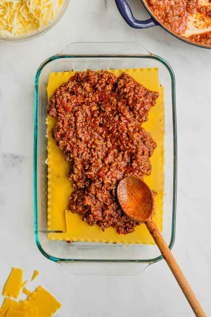 The second layer of meat sauce added to the pan for mom's lasagna recipe.