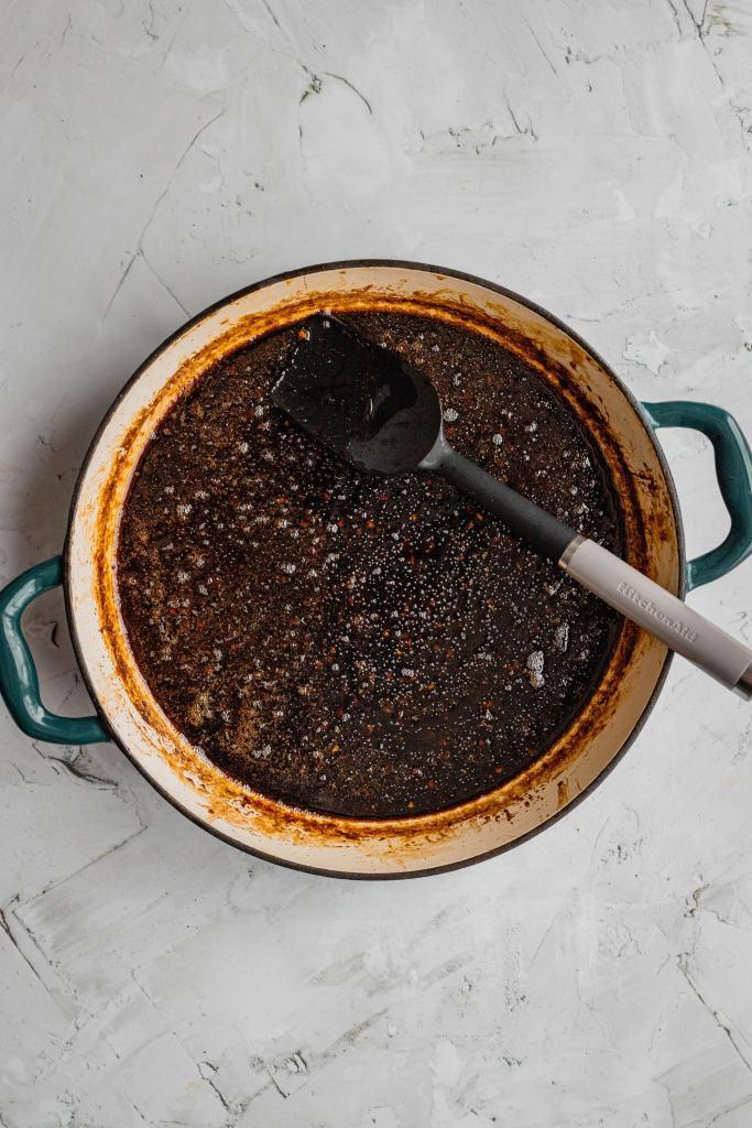 Honey balsamic glaze in a shallow Dutch oven.