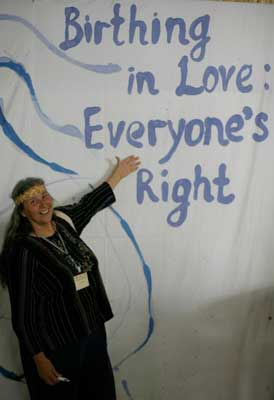 "Jan Tritten shows off the conference theme, ""Birthing in Love: Everyone's Right"""
