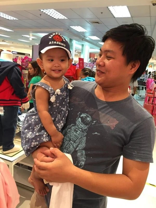 Mikayla on a baseball cap and her dad
