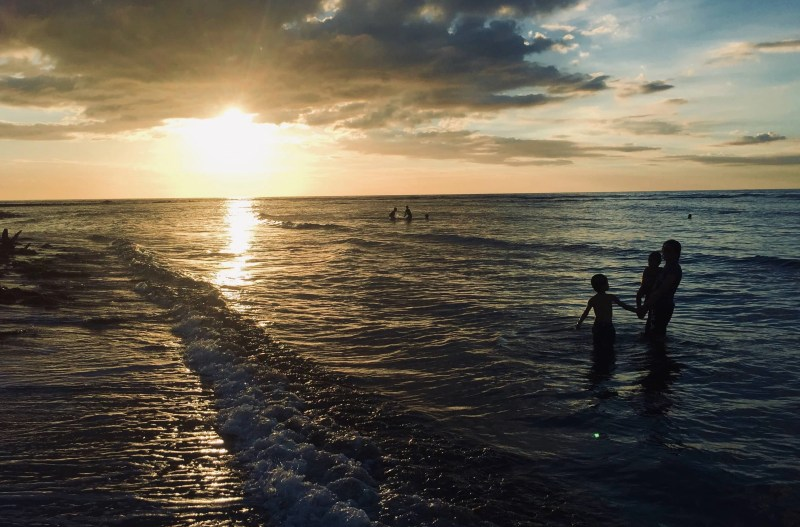Our beautiful silhouettes under a sunset at Masinloc Zambales Beach