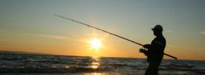 personne pêche couché de soleil
