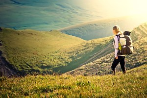 Managing the email inbox - Image: woman hiking over hills
