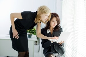 business women looking at a laptop