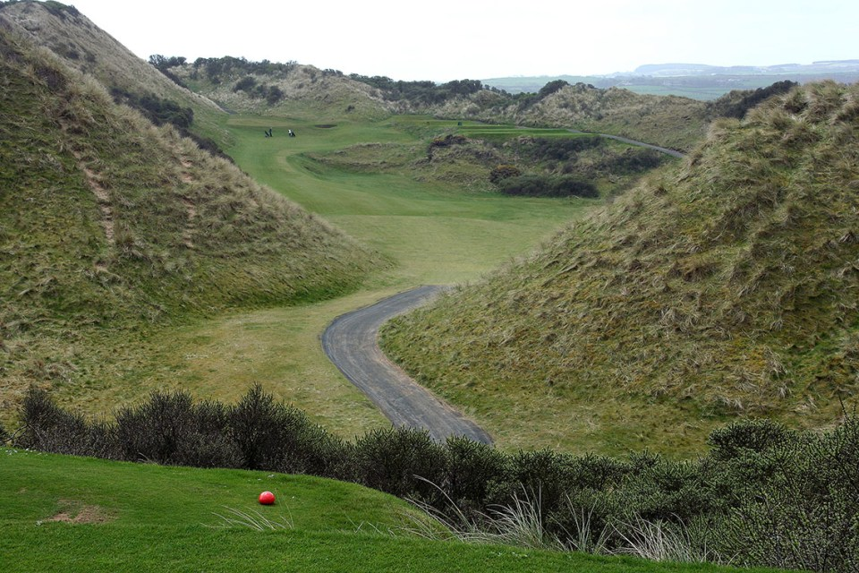 We crisscross between the dunes, playing off high tees across or along the valleys