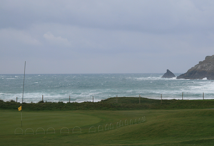 Trevose is a demanding, classic links. Especially when like this with the wind straight in from the sea and over Trevose Head onto the 4th green.  (Photo: The Migrant Golfer)