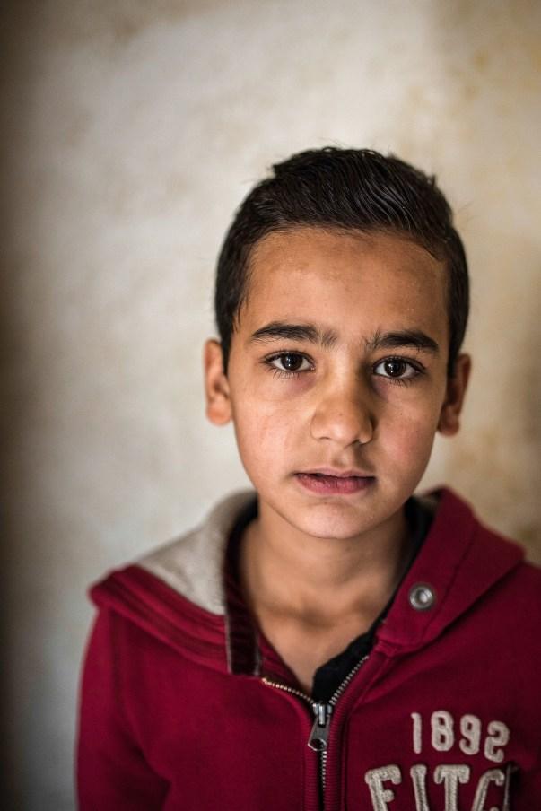 IRBID-JORDAN Home visit of ICMC staff. Masleh family, Syrian refugees. Portrait of Abdel (13).