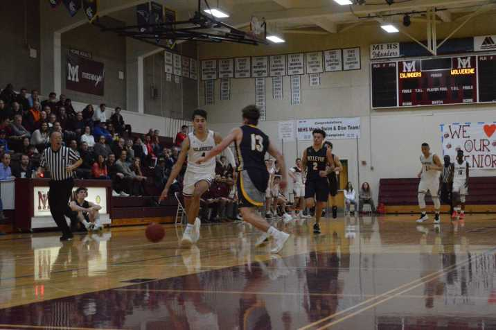 Adam Parker drives past a Bellevue defender for the layup.