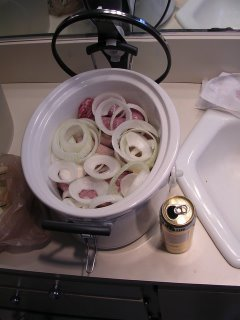 Three kinds of brats, Johnsonville Stadium, Turkey, and local Deli, and a large onion in my new crockpot