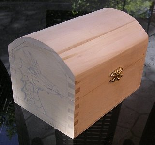 Dragon tracing on the side of a small wooden chest for wood carving.