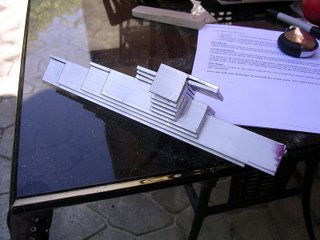 Stacked aluminum brackets.