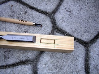 Starting to cut the mortise wood joint with a chisel