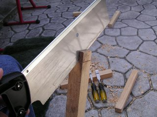 cutting a wood tenon joint with a handsaw