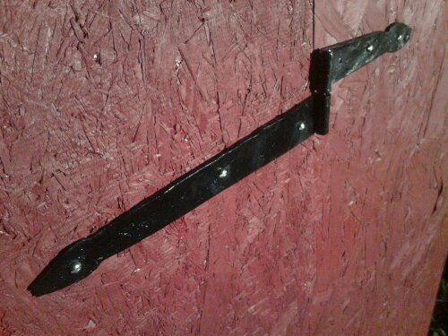 Hinge on the toy barn door