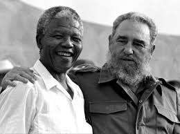 A grateful Nelson Mandela and Fidel Castro
