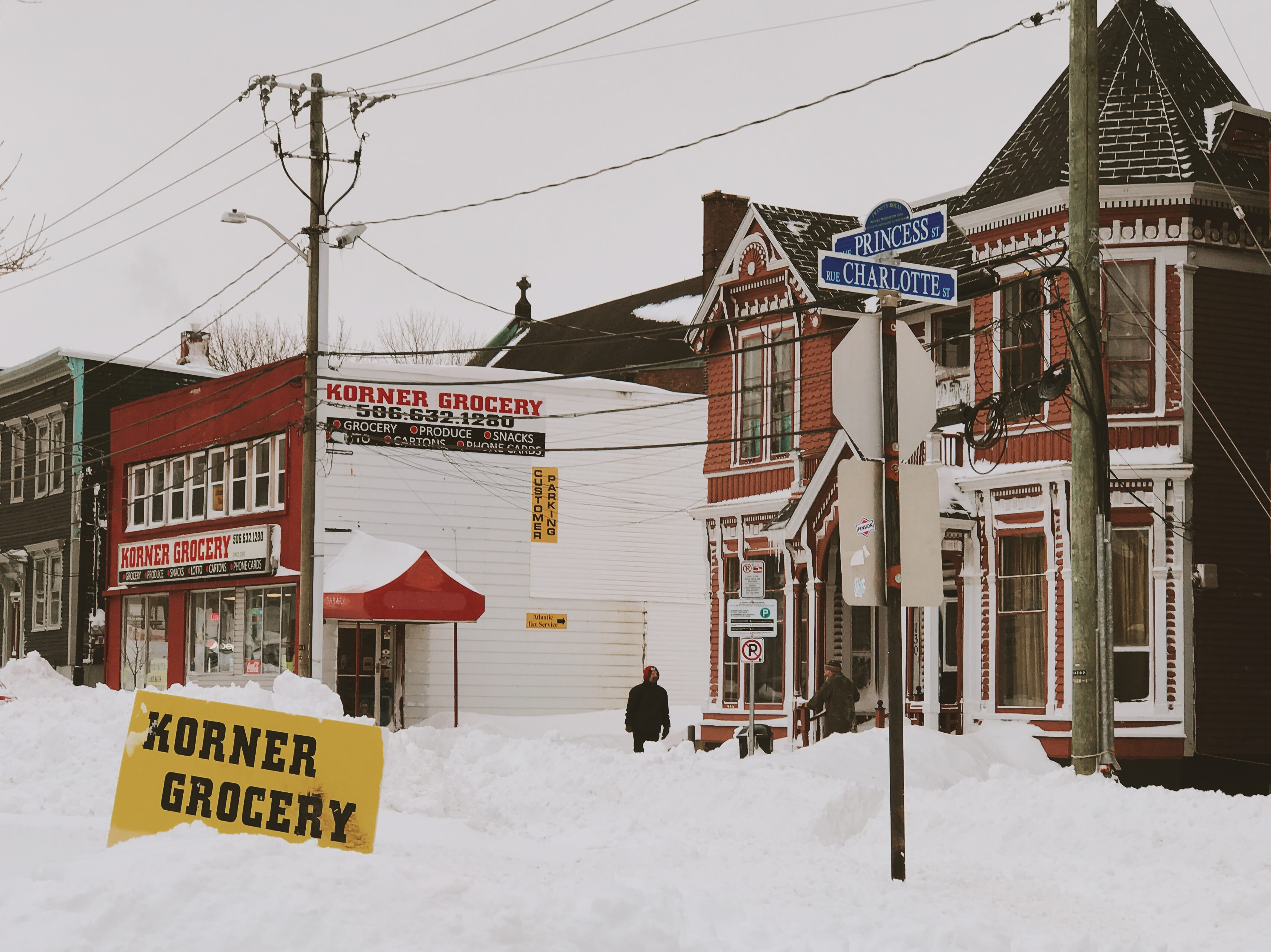 A photograph depicting Korner Grocery Intersection Snow