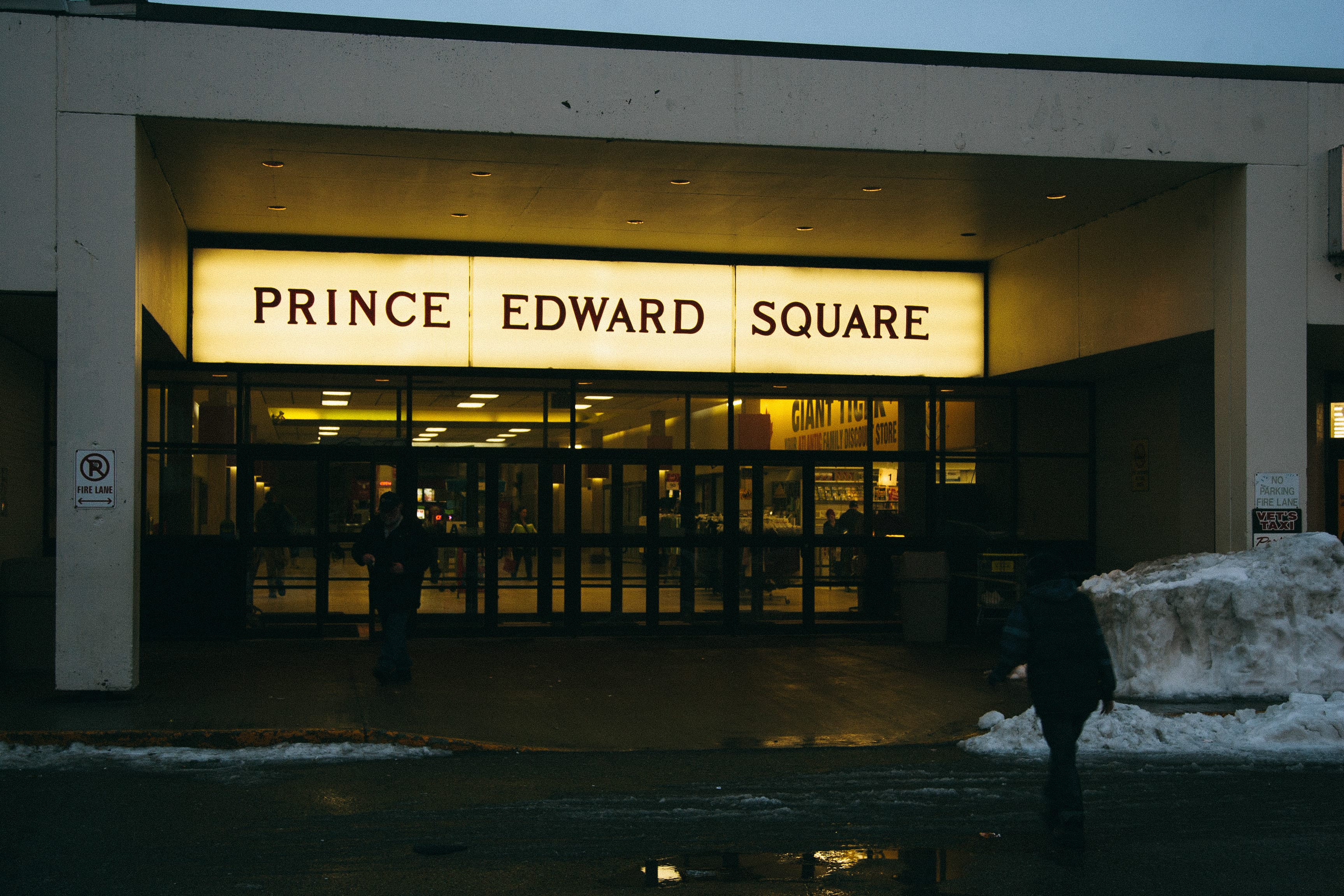 A photograph depicting Prince Edward Square Entrance at Dusk