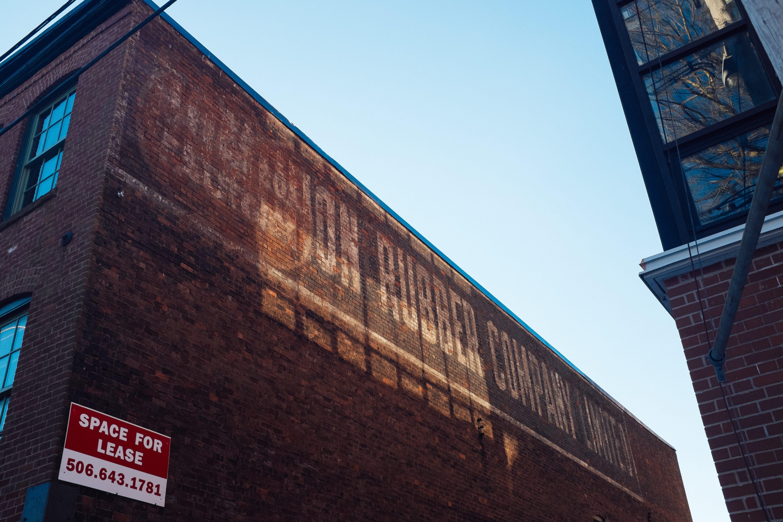A photograph depicting Rubber Company Brick Wall Saint John