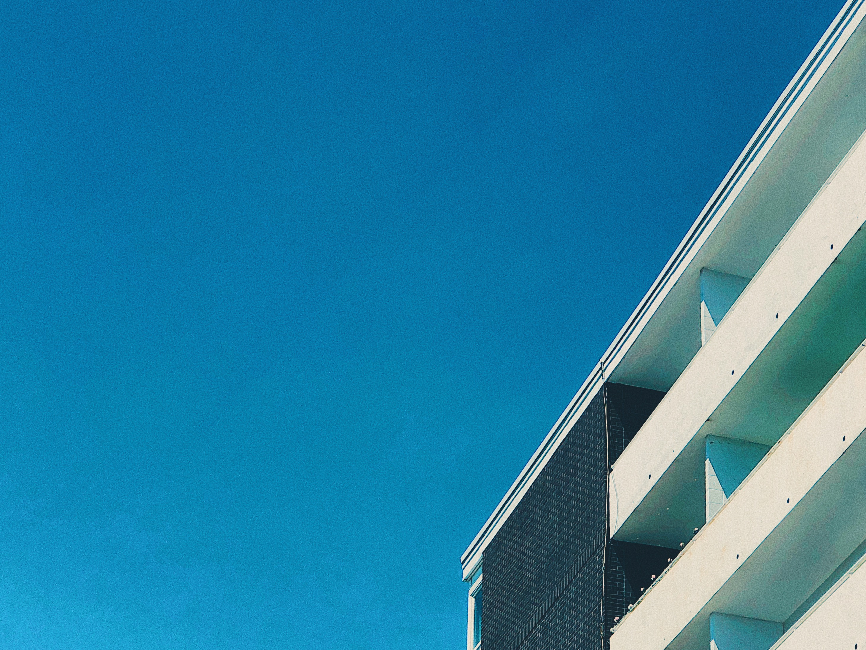 A photograph depicting Saint John Apartment Building Edge