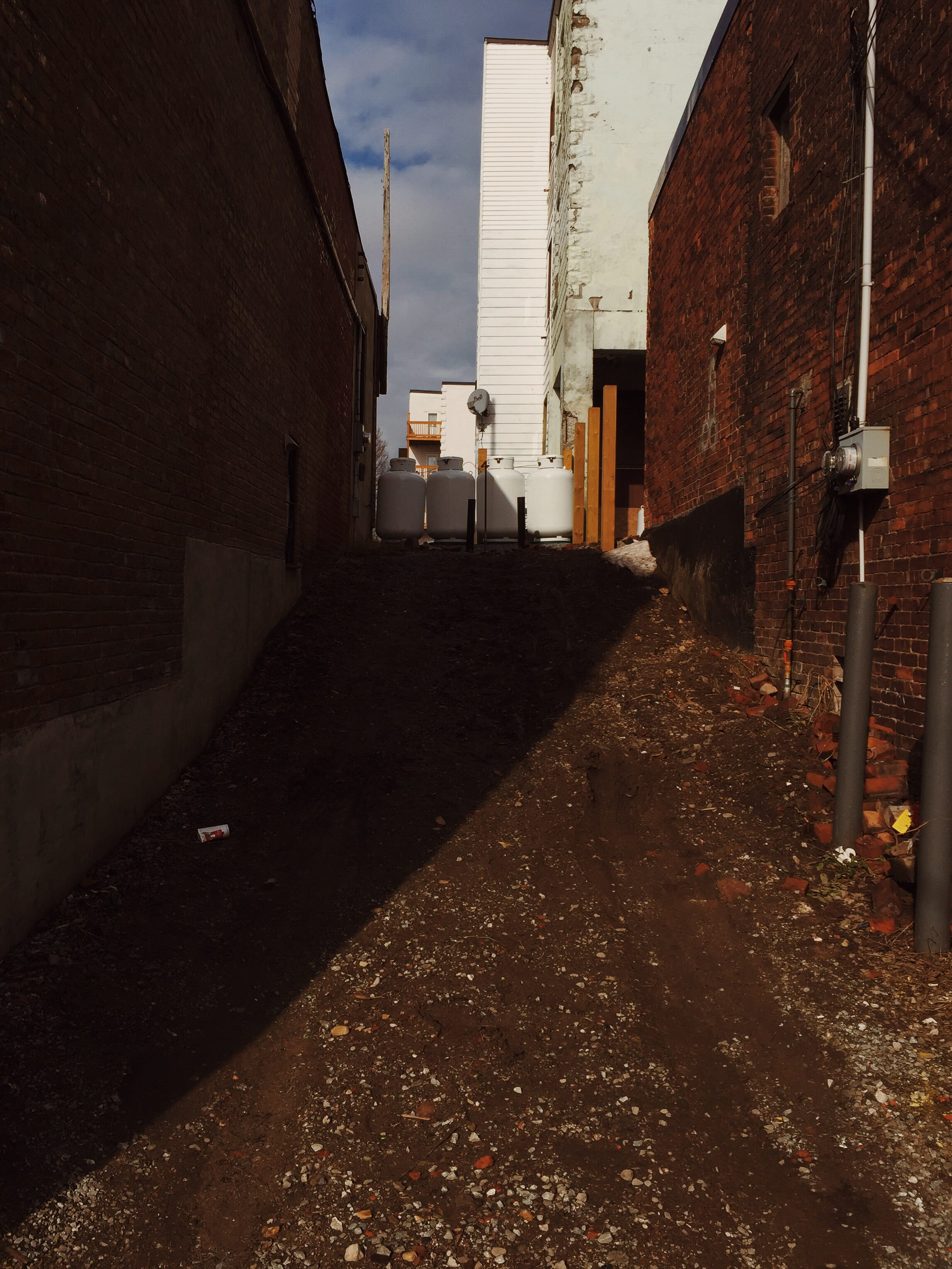 A photograph depicting Propane Tanks in Alleyway