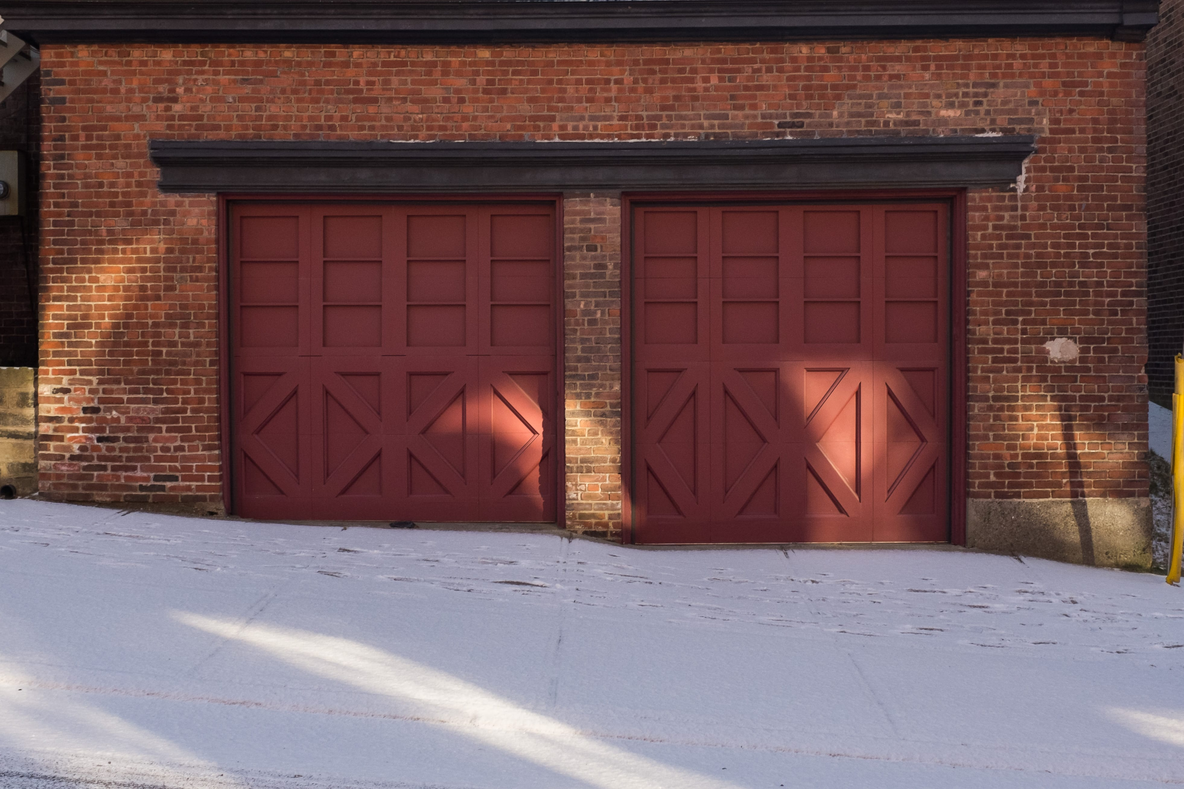 A photograph depicting Two Door Red Garage on Duke