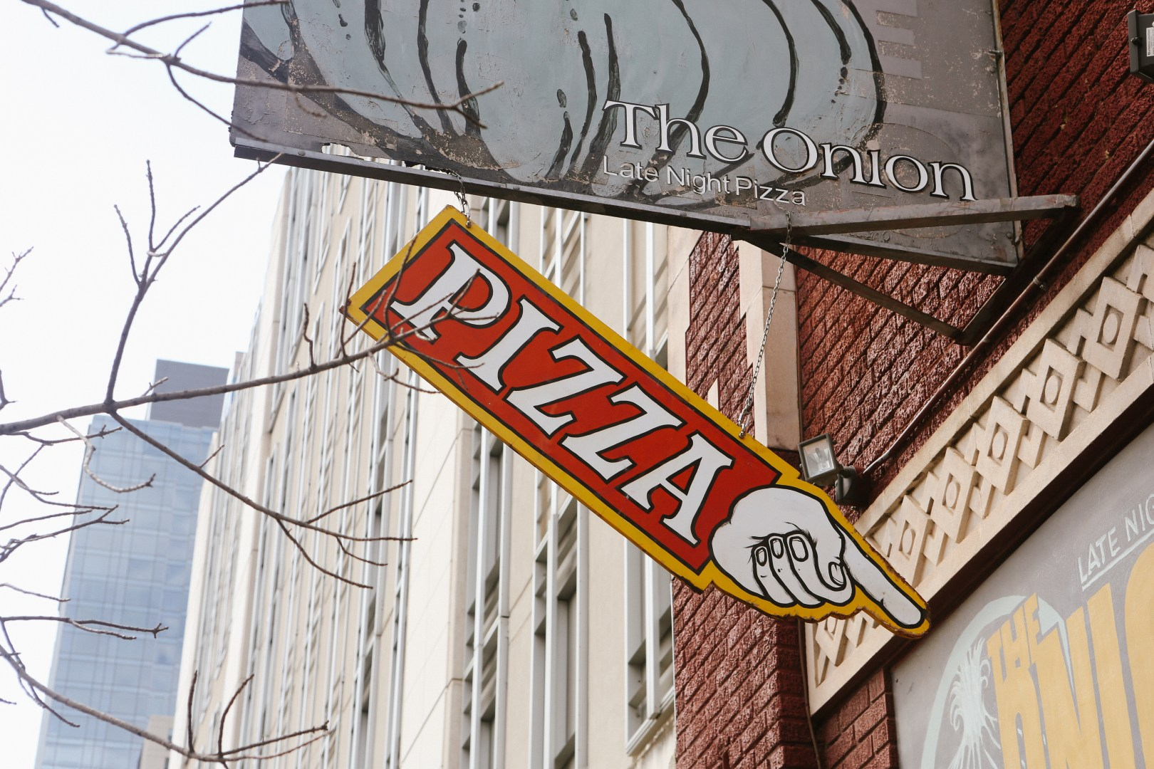 A photo of Austin Texas Pizza Sign Pointing